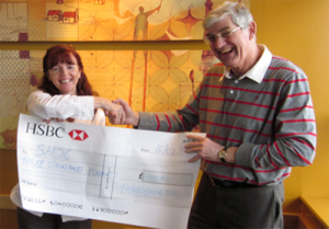 Brid Vaughan presenting the cheque to Ray Waite at SHOC